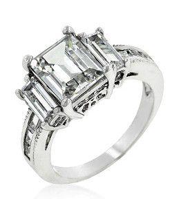 Miss Jewels - 5.10ctw Emerald Cut Triplet Engagement Ring